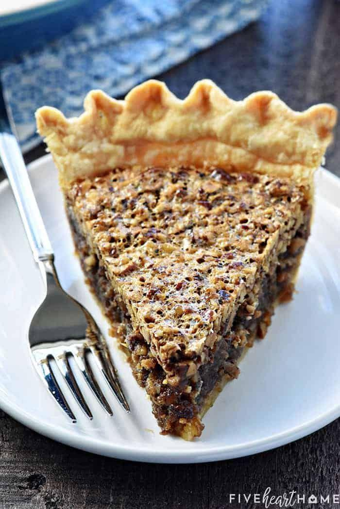 """<p>Try your hand at a winter classic—a flaky, buttery crust filled with an abundance of sugary pecans. </p><p><a href=""""https://www.fivehearthome.com/best-pecan-pie-recipe/"""" rel=""""nofollow noopener"""" target=""""_blank"""" data-ylk=""""slk:Get the recipe"""" class=""""link rapid-noclick-resp"""">Get the recipe</a>.</p>"""