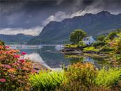 """<p>Known as the 'Jewel of the Highlands', Plockton is a lovely little waterside village surrounded by a classic Highland landscape of pine trees and snow-capped mountains. </p><p>The glassy waters of Loch Carron are often busy with yachts and small fishing boats, and a handful of great restaurants mean it's a great destination for foodies too - but it's just as much a place for simply breathing in some fresh air and re-energising body and soul.</p><p><strong>Browse Prima's selection of amazing Scottish staycations, from <a href=""""https://www.primaholidays.co.uk/tours/scotland-shetland-islands-knitting"""" rel=""""nofollow noopener"""" target=""""_blank"""" data-ylk=""""slk:knitting in the Shetlands"""" class=""""link rapid-noclick-resp"""">knitting in the Shetlands</a> to a <a href=""""https://www.primaholidays.co.uk/tours/scotland-edinburgh-glasgow-golden-horizon-tradewind-cruise"""" rel=""""nofollow noopener"""" target=""""_blank"""" data-ylk=""""slk:cruise from the east to the west coast"""" class=""""link rapid-noclick-resp"""">cruise from the east to the west coast</a>.</strong></p><p><a class=""""link rapid-noclick-resp"""" href=""""https://www.primaholidays.co.uk/search?locations%5Bsearch%5D=Scotland%2C+UK&locations%5Bgeo%5D=54.633238%2C-8.650007%2C60.860751%2C-0.724675"""" rel=""""nofollow noopener"""" target=""""_blank"""" data-ylk=""""slk:BROWSE NOW"""">BROWSE NOW</a></p><p><strong>We want to help you stay inspired. <a href=""""https://hearst.emsecure.net/optiext/optiextension.dll?ID=iJB5XQ9hbysIihBPVSR1SDFHDwOevp5cB7mtotiL0TWlZ15eC%2BWQWXYp3HVN6xoPbvNGcYnocErOiJ"""" rel=""""nofollow noopener"""" target=""""_blank"""" data-ylk=""""slk:Sign up"""" class=""""link rapid-noclick-resp"""">Sign up</a> for the latest travel tales and to hear about our favourite financially protected escapes and bucket list adventures.</strong></p><p><a class=""""link rapid-noclick-resp"""" href=""""https://hearst.emsecure.net/optiext/optiextension.dll?ID=iJB5XQ9hbysIihBPVSR1SDFHDwOevp5cB7mtotiL0TWlZ15eC%2BWQWXYp3HVN6xoPbvNGcYnocErOiJ"""" rel=""""nofollow noopener"""" target=""""_blank"""" data-ylk=""""slk:SIGN UP"""">SIGN UP"""