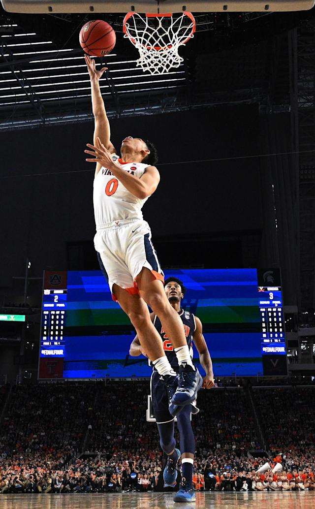 Kihei Clark #0 of the Virginia Cavaliers shoots against the Auburn Tigers during the first half of the semifinal game in the NCAA Men's Final Four at U.S. Bank Stadium on April 06, 2019 in Minneapolis, Minnesota. (Photo by Brett Wilhelm/NCAA Photos via Getty Images)