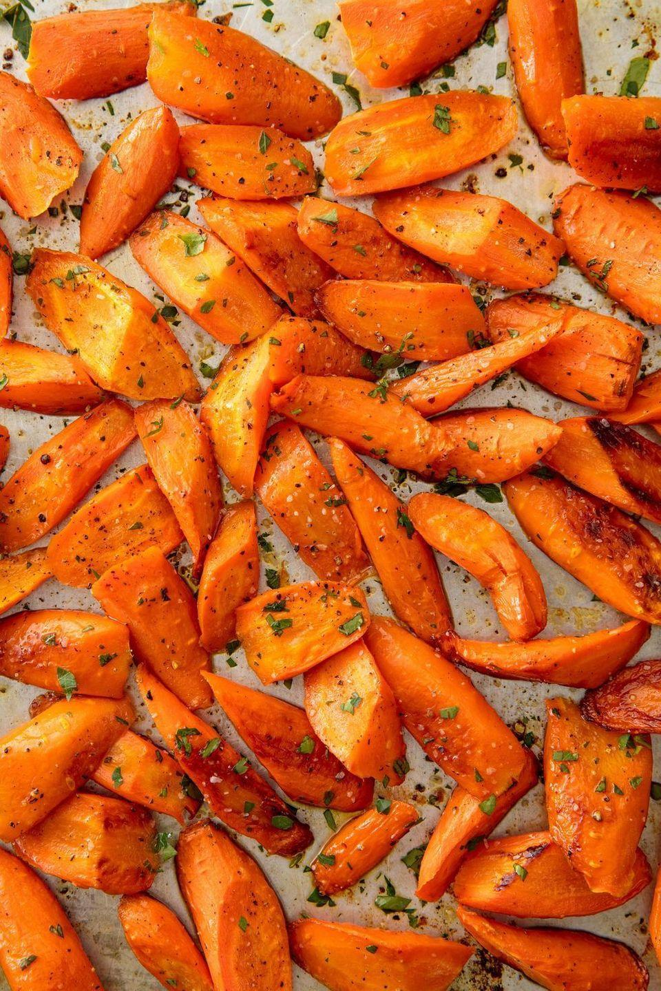 """<p>Our biggest piece of advice: Don't overcrowd the pan.</p><p>Get the <a href=""""https://www.delish.com/uk/cooking/recipes/a29571518/oven-roasted-carrots-recipe/"""" rel=""""nofollow noopener"""" target=""""_blank"""" data-ylk=""""slk:Roasted Carrots"""" class=""""link rapid-noclick-resp"""">Roasted Carrots</a> recipe.</p>"""