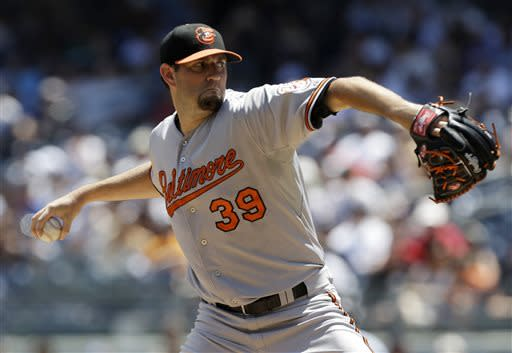 Baltimore Orioles starting pitcher Jason Hammel delivers in the first inning against the New York Yankees in a baseball game on Sunday, July 7, 2013, in New York. (AP Photo/Kathy Willens)