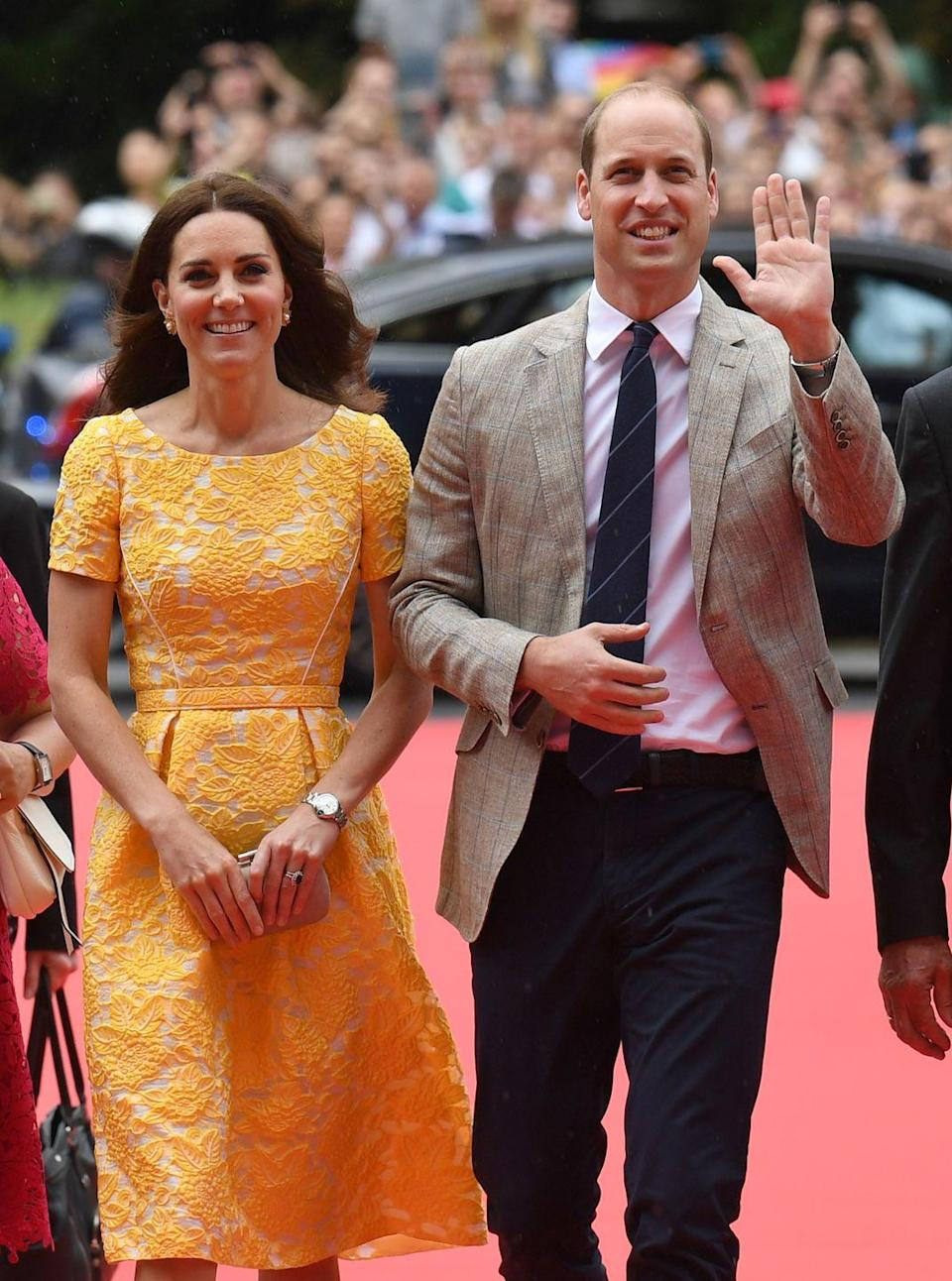 <p>Kate paid homage to the golden yellow of Germany's flag in a custom lace dress from royal favorite Jenny Packham. She paired the look with a small clutch and taupe espadrille wedges.</p>