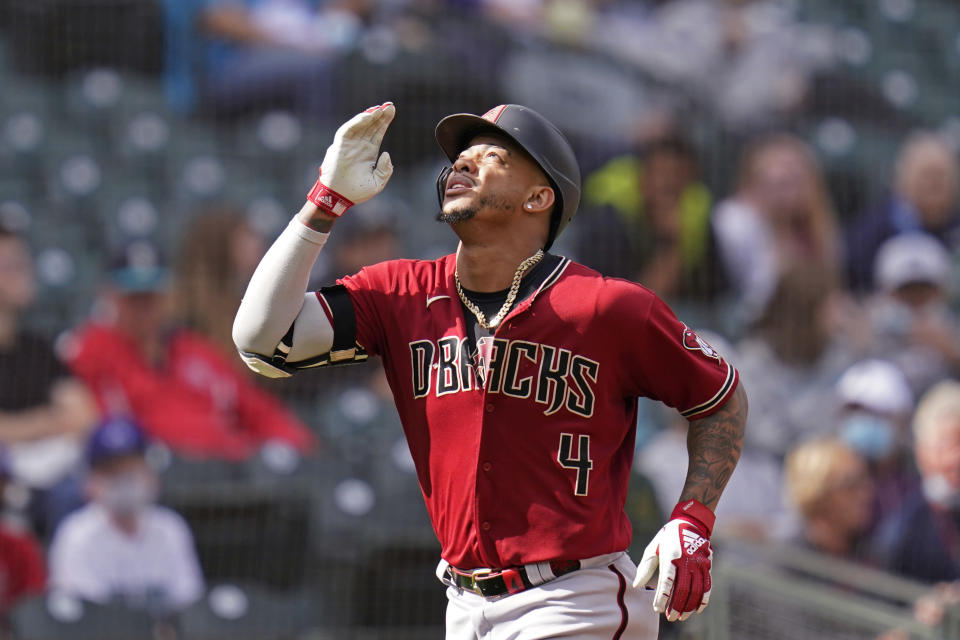 Arizona Diamondbacks' Ketel Marte motions as he heads home on his solo home run against the Seattle Mariners in the seventh inning of a baseball game Sunday, Sept. 12, 2021, in Seattle. (AP Photo/Elaine Thompson)