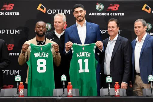 BOSTON, MA - JULY 17: Kemba Walker #8 and Enes Kanter #11 of the Boston Celtics pose for a photo during the introductory press conference on July 17, 2019 at the Auerbach Center in Boston, Massachusetts. (Photo by Brian Babineau/NBAE via Getty Images)
