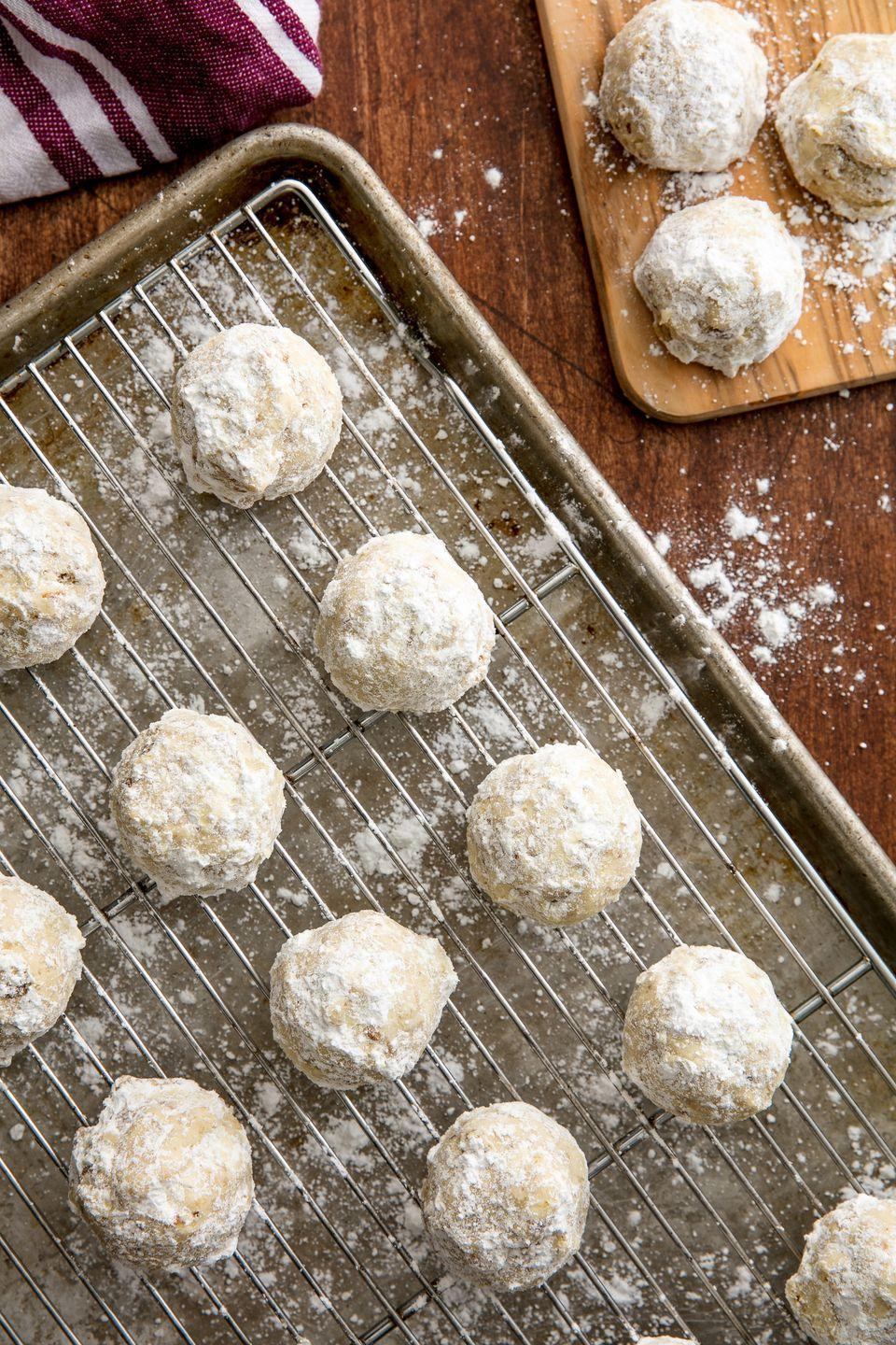 """<p>You can have a snowball fight over these cookies!</p><p>Get the recipe from <a href=""""https://www.delish.com/cooking/recipe-ideas/recipes/a56364/best-snowball-cookies-recipe/"""" rel=""""nofollow noopener"""" target=""""_blank"""" data-ylk=""""slk:Delish"""" class=""""link rapid-noclick-resp"""">Delish</a>. </p>"""