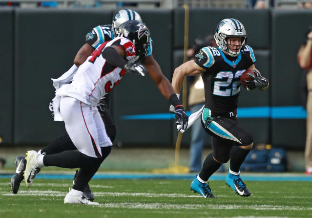 Carolina Panthers' Christian McCaffrey (22) runs past Atlanta Falcons' Brian Poole (34) during the first half of an NFL football game in Charlotte, N.C., Sunday, Dec. 23, 2018. (AP Photo/Jason E. Miczek)