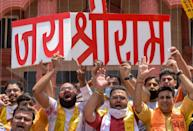 Workers of Bharatiya Janata Yuva Morcha, the youth wing of the Bharatiya Janata Party (BJP), shout slogans and hold cut-out words reading 'Jai Shri Ram' (Glory to Lord Ram) as they celebrate the groundbreaking ceremony of the Ram Temple in Ayodhaya, at the Ram Tirath Temple in Amritsar on August 5, 2020. - India's Prime Minister Narendra Modi will lay the foundation stone for a grand Hindu temple in a highly anticipated ceremony on August 5 at a holy site that was bitterly contested by Muslims, officials said. The Supreme Court ruled in November 2019 that a temple could be built in Ayodhya, where Hindu zealots demolished a 460-year-old mosque in 1992. (Photo by NARINDER NANU / AFP) (Photo by NARINDER NANU/AFP via Getty Images)