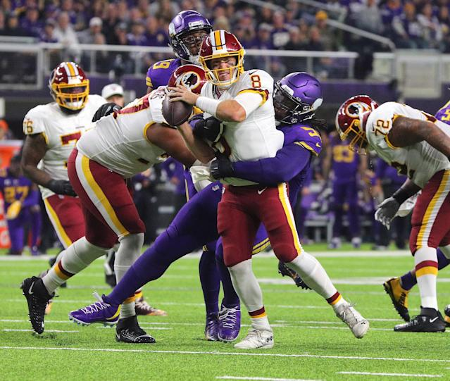Case Keenum gets sacked by the Vikings in a loss Thursday night. (Getty Images)