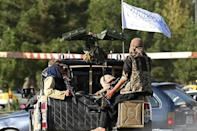 In one of the greater ironies after two decades of war, racing to meet the August 31 deadline for the US withdrawal has meant close cooperation with the Taliban on evacuee movements and the IS threat (AFP/Aamir QURESHI)