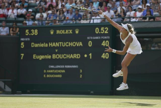 Eugenie Bouchard of Canada serves to Daniela Hantuchova of Slovakia in their women's singles tennis match at the Wimbledon Tennis Championships, in London June 24, 2014. REUTERS/Stefan Wermuth (BRITAIN - Tags: SPORT TENNIS)