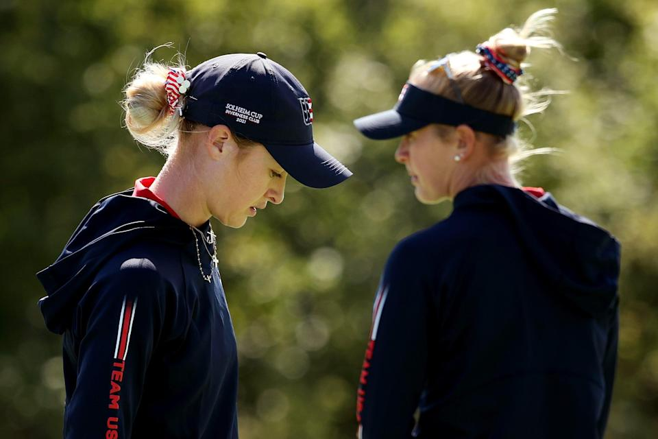 Americans Nelly Korda and Jessica Korda look on during a practice round ahead of the start of The Solheim Cup at Inverness Club in Toledo, Ohio.