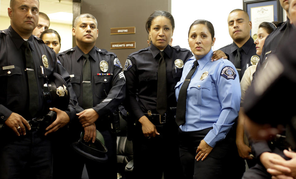 Officers on the Maywood Police force come together for their last briefing before being disbanded a (Gina Ferazzi / Los Angeles Times via Getty Images file)