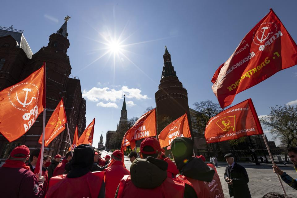 Communists party supporters gather with red flags to mark Labour Day, also knows as May Day near Red Square in Moscow, Russia, Saturday, May 1, 2021. (AP Photo/Alexander Zemlianichenko)