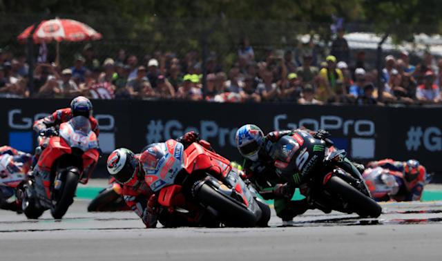 Motorcycling - MotoGP - French Grand Prix - Bugatti Circuit, Le Mans, France - May 20, 2018 Ducati Team's Jorge Lorenzo and Monster Yamaha Tech 3's Johann Zarco during the race REUTERS/Gonzalo Fuentes