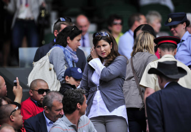 Mirka Vavrinec (C) partner of Swiss player Roger Federer, arrives on Centre Court to watch him play against Kazakh player Mikhail Kukushkin during a Men's Singles match at the 2011 Wimbledon Tennis Championships at the All England Tennis Club, in south-west London, on June 21, 2011. AFP PHOTO/GLYN KIRK/RESTRICTED TO EDITORIAL USE (Photo credit should read GLYN KIRK/AFP/Getty Images)