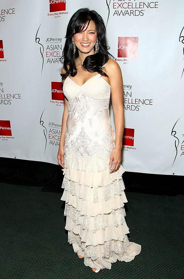 "Kelly Hu is a vision in white. The ""X-Men"" star also chose Sue Wong, with matching chandelier earrings by Jose Barrera. Alberto Rodriguez/<a href=""http://www.gettyimages.com/"" target=""new"">GettyImages.com</a> - April 23, 2008"