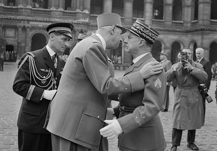 President Charles de Gaulle presents the cross of the Legion of Honor to General Charles Ailleret on March 10, 1960 during a military rally in the Cour d'honneur of the Invalides in Paris
