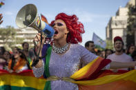 A participant dances in the annual Gay Pride parade in Jerusalem, Thursday, June 3, 2021. Thousands of people marched through the streets of Jerusalem on Thursday in the city's annual gay pride parade. (AP Photo/Ariel Schalit)