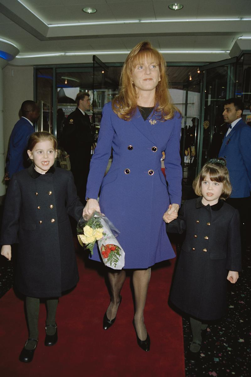 The Duchess of York attends a charity premiere of 'A Little Princess' in London, with her daughters Beatrice and Eugenie, 1996. Photo by Dave Benett/Getty Images.