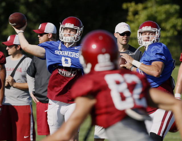 FILE - In this Aug. 17, 2017, file photo, Oklahoma quarterbacks Tanner Schafer, left, and Austin Kendall, right, throw during NCAA college football practice in Norman, Okla. Oklahoma will start figuring out who will replace Heisman Trophy-winning quarterback Baker Mayfield when spring practice opens. The top two contenders will be last year's backup, redshirt junior Kyler Murray, and redshirt sophomore Austin Kendall. Redshirt sophomore Tanner Schafer will get a look, too. (AP Photo/Sue Ogrocki, File)