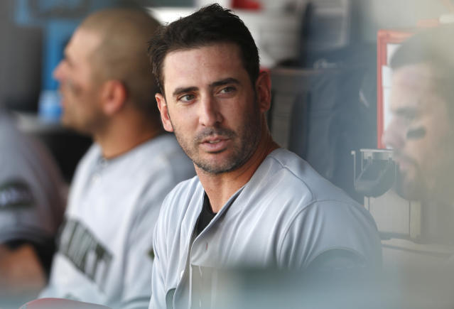 Cincinnati Reds starting pitcher Matt Harvey waits in the dugout to bat after retiring the Colorado Rockies in the third inning of a baseball game Sunday, May 27, 2018, in Denver. (AP Photo/David Zalubowski)