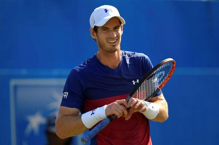 FILE PHOTO: Britain Tennis - Aegon Championships - Queen's Club, London - June 20, 2017 Great Britain's Andy Murray looks dejected during his first round match against Australia's Jordan Thompson Action Images via Reuters / Tony O'Brien Livepic/File Photo