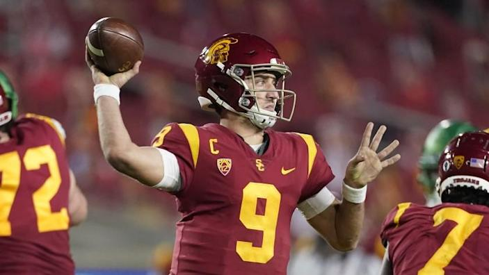 Southern California quarterback Kedon Slovis (9) throws a pass during the first half of an NCAA college football game for the Pac-12 Conference championship against Oregon Friday, Dec 18, 2020, in Los Angeles. (AP Photo/Ashley Landis)