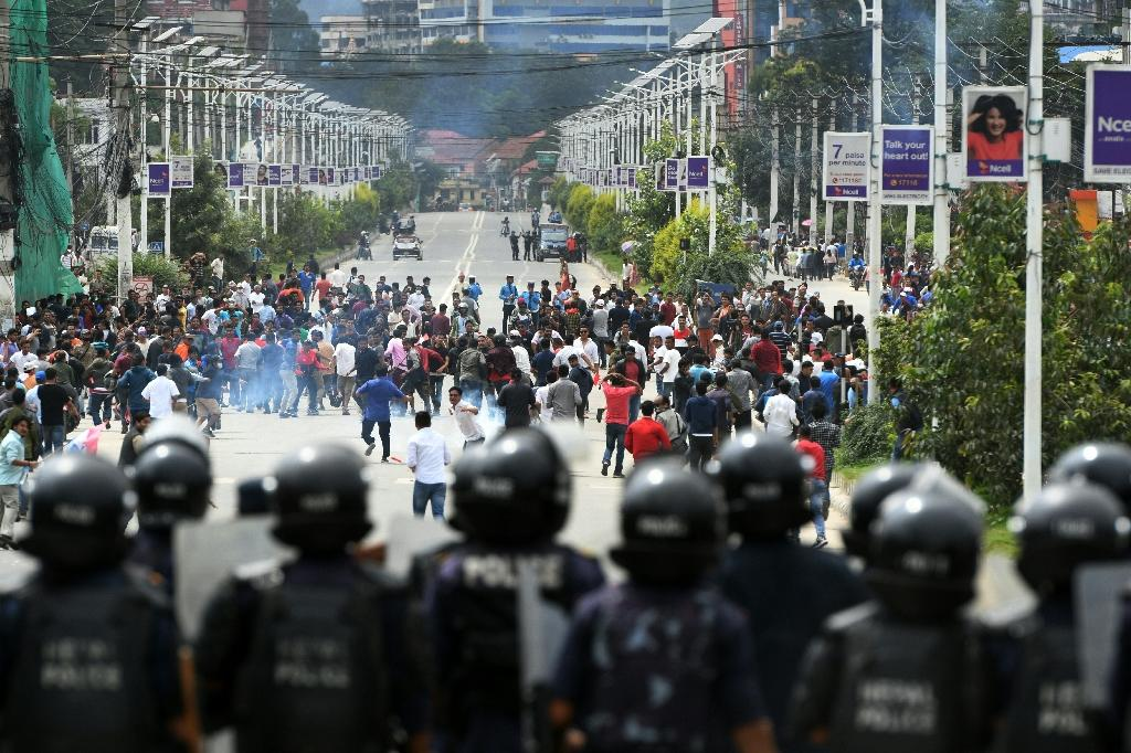 Nepali police use tear gas to disperse crowds of the Tarun Dal, the youth wing of Nepali Congress Party, during a demonstration in support of a hunger-striking doctor seeking better healthcare (AFP Photo/PRAKASH MATHEMA)