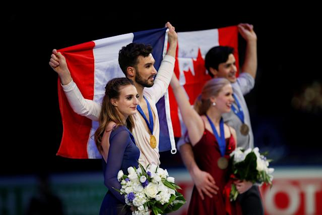 Figure Skating - World Figure Skating Championships - The Mediolanum Forum, Milan, Italy - March 24, 2018 France's Gabriella Papadakis and Guillaume Cizeron pose after winning the gold medal in the Ice Dance with third placed Canada's Kaitlyn Weaver and Andrew Poje REUTERS/Alessandro Garofalo