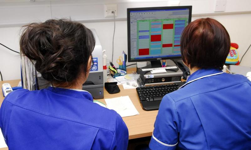 Nurses looking at a computer