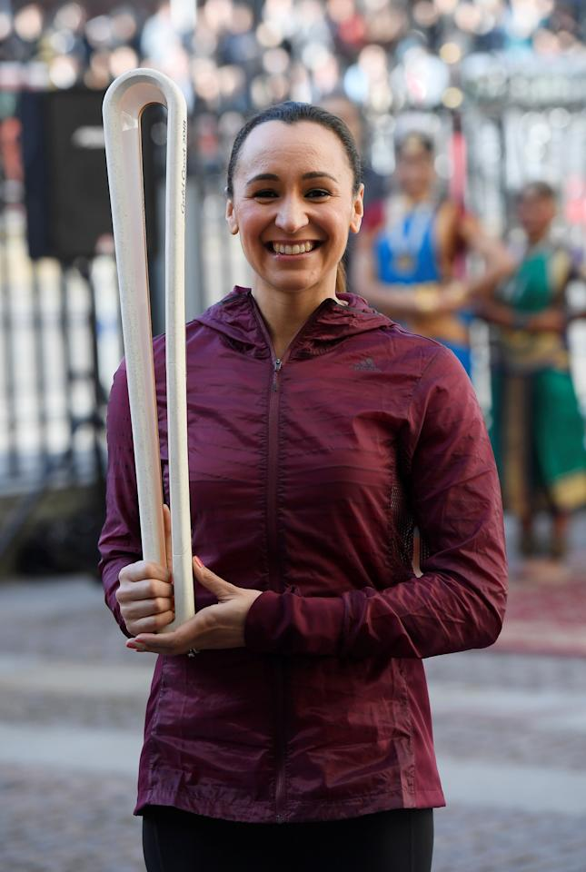 Former British athlete Jessica Ennis-Hill poses with the Commonwealth Games baton ahead of a Commonwealth Day service at Westminster Abbey in London, Britain March 13, 2017. REUTERS/Toby Melville