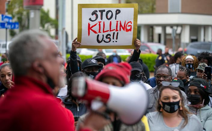 <p>Kirk Rivers addresses demonstrators outside City Hall as they await members of the city council who held an emergency meeting on Friday, April 23, 2021, in Elizabeth City, N.C., in regards to the death of Andrew Brown Jr., who was shot and killed by a Pasquotank County Deputy Sheriff earlier in the week. </p> ((Robert Willett/The News & Observer via AP))