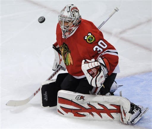 Chicago Blackhawks goalie Ray Emery makes a save against the New York Rangers during the third period of an NHL hockey game in Chicago, Friday, March 9, 2012. Chicago won 4-3. (AP Photo/Paul Beaty)