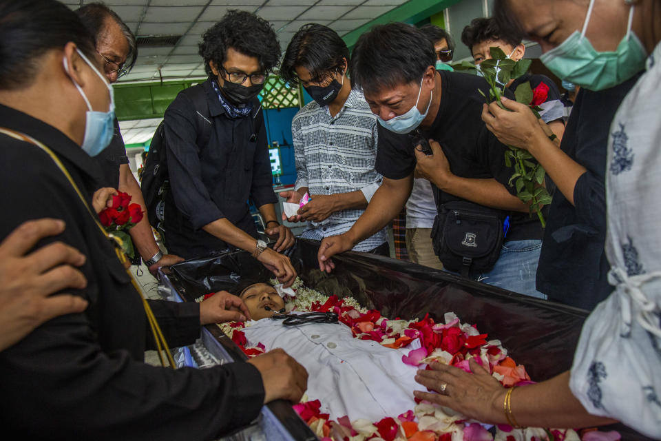 FILE - In this March 16, 2021, file photo, a man weeps at the funeral of Khant Ngar Hein in Yangon, Myanmar, who was shot in the chest during a protest. One hundred days since their takeover, Myanmar's ruling generals maintain just the pretense of control over the country. There are fears the military takeover is turning Myanmar into a failed state. (AP Photo, File)