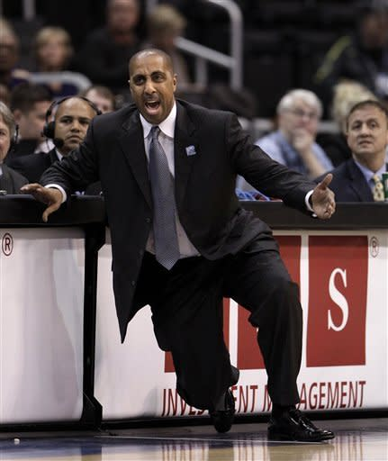 Washington head coach Lorenzo Romar directs his team during the first half of an NCAA college basketball game against Oregon State at the Pac-12 Conference championship in Los Angeles, Thursday, March 8, 2012. (AP Photo/Jae C. Hong)
