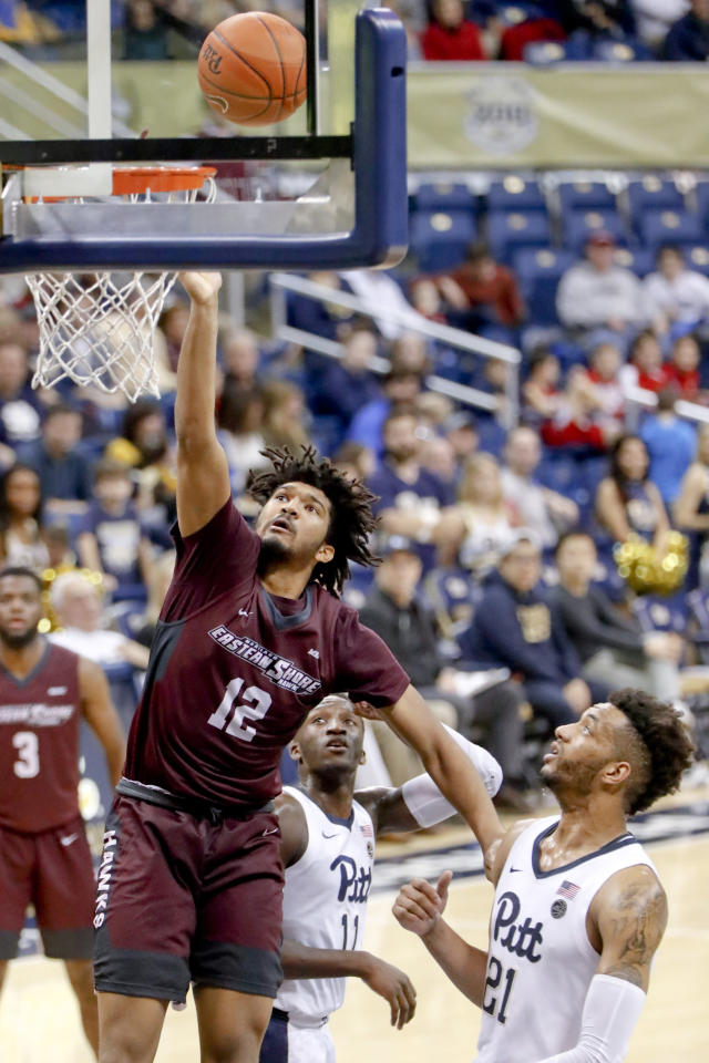 Maryland Eastern Shore's AJ Cheeseman (12) shoots after getting around Pittsburgh's Terrell Brown (21) during the second half of an NCAA college basketball game, Saturday, Dec. 15, 2018, in Pittsburgh. Pittsburgh won 78-43.(AP Photo/Keith Srakocic)