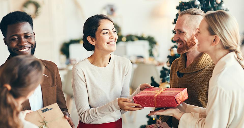 People giving gifts at Christmas