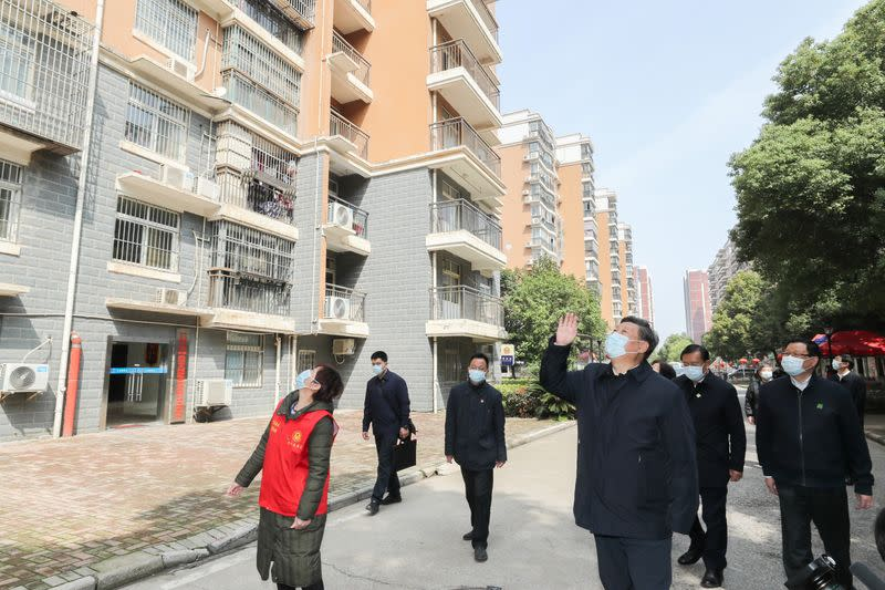Chinese President Xi Jinping waves to residents who are quarantined at home and sends regards to them at a community in Wuhan