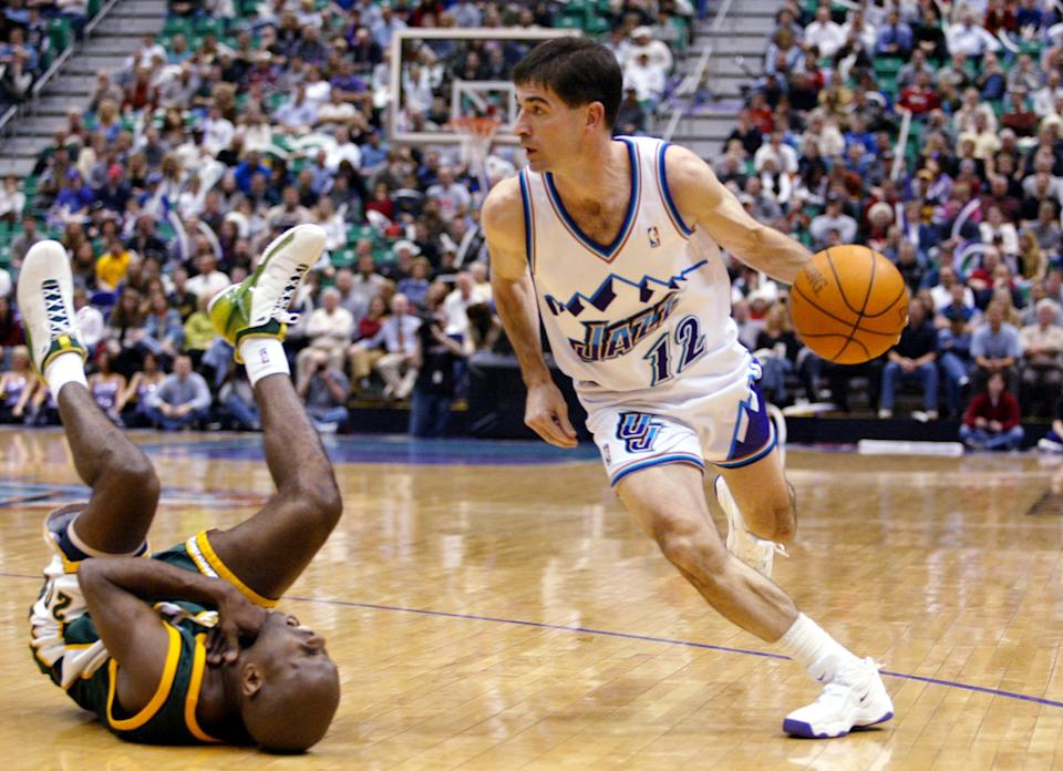 Seattle SuperSonics guard Gary Payton, left, falls back while gasping for air after Utah Jazz guard John Stockton, right, elbowed him in the throat before driving toward the basket during the second half Thursday, Jan. 16, 2003, in Salt Lake City. (AP Photo/Steve C. Wilson)