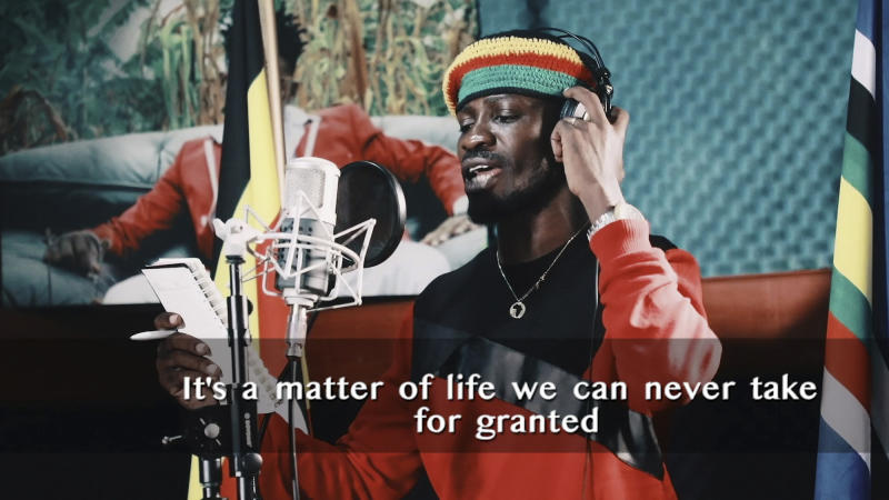 "This image made from video is a frame from the latest music video of Bobi Wine, whose real name is Kyagulanyi Ssentamu, showing the singer recording an informational music video educating the public about the dangers of the new coronavirus and the precautionary measures they should take to fight its spread. Wine, who released a song in March 2020 urging Africa's people to wash their hands to stop the spread of the new coronavirus, is criticizing African governments for not maintaining better health care systems for the continent's 1.3 billion people while investing in weapons and ""curtailing the voices of the people"". (Bobi Wine via AP)"