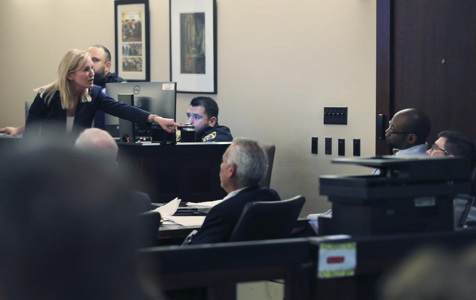 Prosecutor Tamara Strauch points to defendant Otis McKane during closing statements on day 11 of the McKane's capital murder trial for the 2016 shooting of SAPD detective Benjamin Marconi on Monday, July 26, 2021. (Kin Man Hui/The San Antonio Express-News via AP)