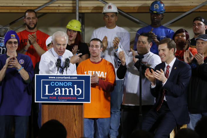 Former Vice President Joe Biden points at Conor Lamb, right, the Democratic candidate in the March 13 special election in Pennsylvania's 18th Congressional District, during a rally at the Carpenter's Training Center in Collier, Pa., March 6, 2018. (Photo: Gene J. Puskar/AP)