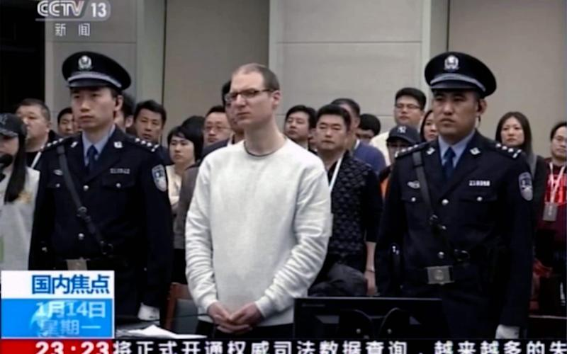 Canadian Robert Lloyd Schellenberg attends his retrial at the Dalian Intermediate People's Court in Dalian, northeastern China - CCTV