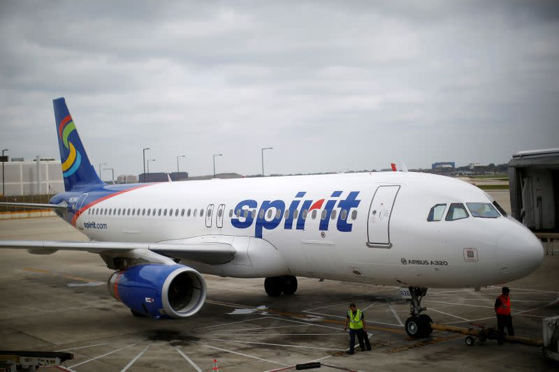 FILE PHOTO: A Spirit Airlines A320-200 airplane sits at a gate at the O'Hare Airport in Chicago, Illinois