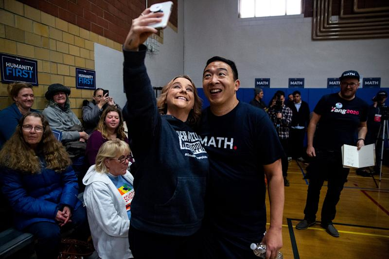 Democratic Presidential Candidate Andrew Yang poses for a selfie with Mindi Callison, of Ames, after playing a three-on-three basketball game on Thursday, Dec. 12, 2019, at the Ames Community Center.