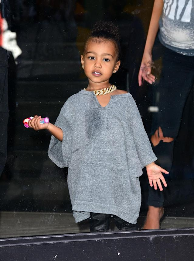 <p>Definitely inherited dad's style for this one. With her oversized angular shaped t-shirt, and large gold chain North is looking a lot like Kanye. (Photo: Getty Images) </p>