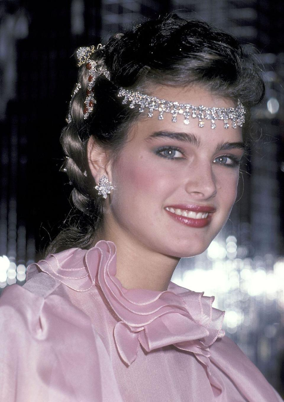 <p>At just 16 years old, Shields was photographed attending a party in New York in 1981. The gathering was in celebration of Shields becoming a spokesperson for Wella Corporation, a hair care company.</p>