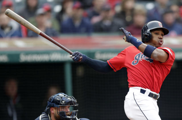 Cleveland Indians' Greg Allen, right, hits a one-run double off Atlanta Braves starting pitcher Julio Teheran in the fifth inning during the first game of a baseball doubleheader, Saturday, April 20, 2019, in Cleveland. Carlos Santana scored on the play. (AP Photo/Tony Dejak)