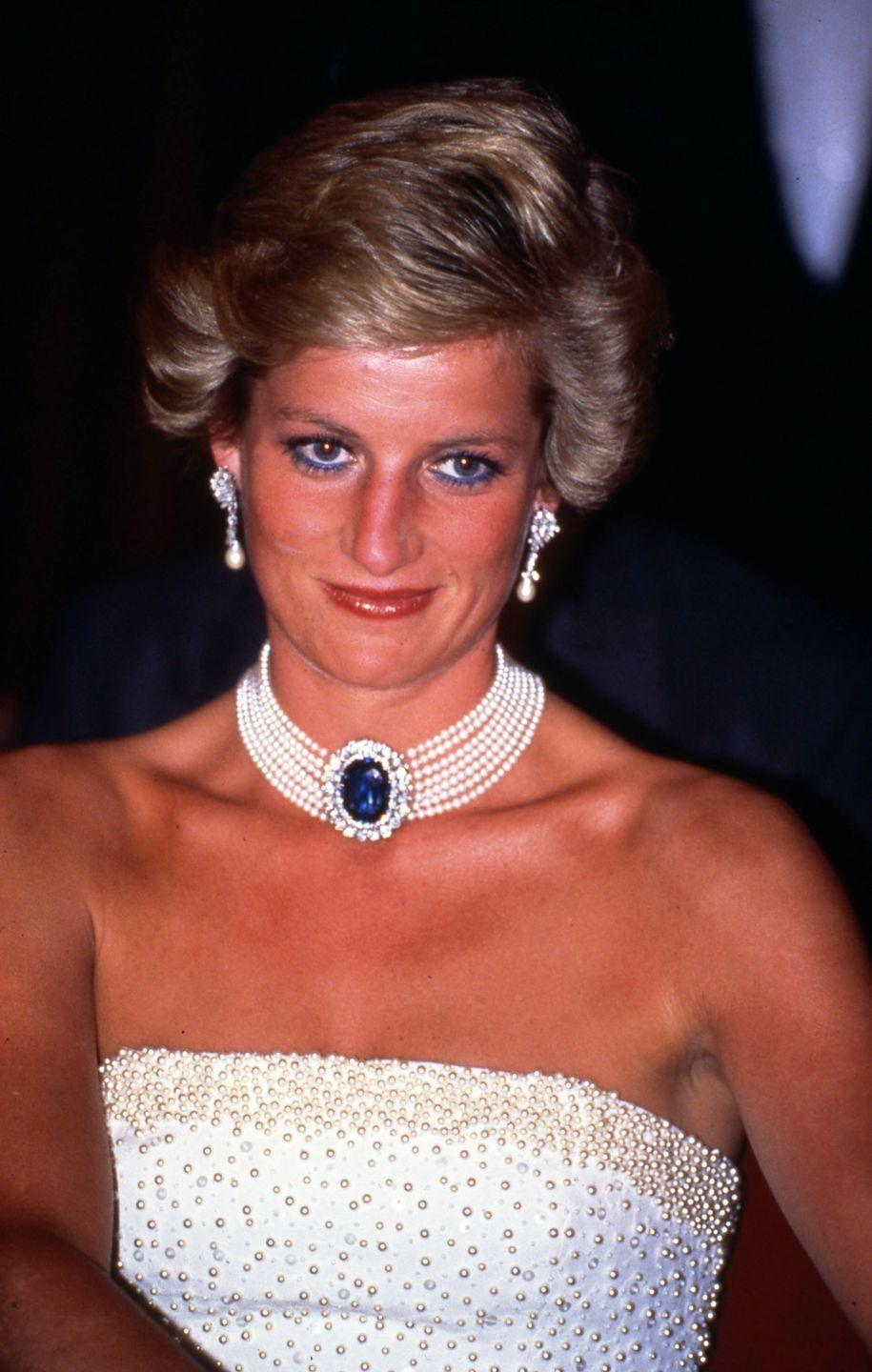 <p>Taking royal fashion to new heights, Princess Diana loved to sport a pearl choker with many of her looks. This layered one featuring a blue and diamond stone was one of her favorites. </p>