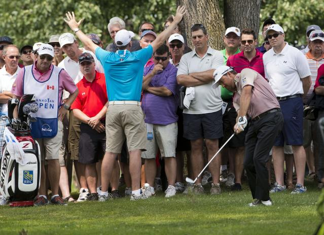 Graeme McDowell, from Northern Ireland, hits out of the rough during second round play at the Canadian Open golf championship Friday, July 25, 2014 in Montreal. (AP Photo/The Canadian Press, Ryan Remiorz)